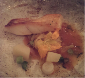 'Pan fried turbot, Bengali turmeric potatoes, raw papaya and spring onion served with Indian olive broth.'